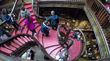 jelentette : March 06, 2017 - PORTO, PORTUGAL: People in the famous Livraria Lello. Livraria Lello is old bookstore in Porto reported to be JK Rowlings inspiration for writing the Harry Potter novels.