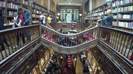 jelentette : March 06, 2017 - PORTO, PORTUGAL: People in the famous Livraria Lello. Livraria Lello is one of the oldest bookstores in Porto reported to be JK Rowlings inspiration for writing the Harry Potter novels.