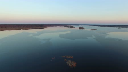 takeoff area : 4K. Flight and takeoff over wild frozen lake in winter on sunset, aerial view.