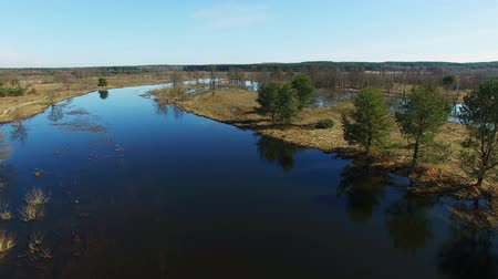 takeoff area : 4K. Low flight and takeoff over flooded blue river in early spring, aerial panoramic view. Stock Footage