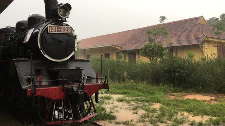 terracota : Retro railway station, Dalat, Lam Dong Province, Vietnam. Old steam engine train locomotive. Nostalgic historical vintage technology background.