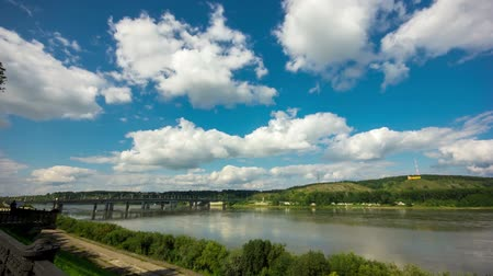 geniş açılı : Beautiful sky with clouds. The bridge over the river in Kemerovo Stok Video
