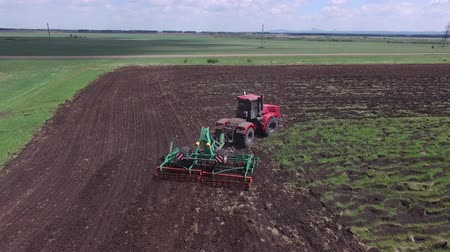 autumns : Tractor sowing seeds in the farm field on sunny autumns day, Stock Footage