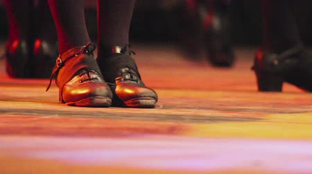 musluk : Woman dancing on stage with traditional Irish dance steps shoes