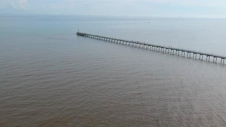 fishing village : fisherman pier bridge on the sea drone shot