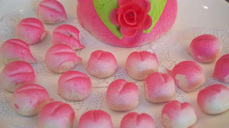 őszibarack : A peach-shaped birthday bun known as the Longevity Peach.Chinese specialty pastry Stock mozgókép