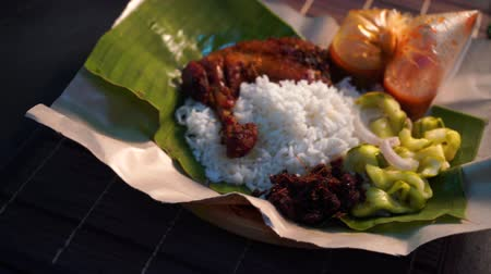 tofu : nasi lemak kukus with drumpstick malaysian local food Stock Footage