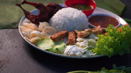 malaya : nasi lemak kukus with  quail meat ,malaysian local food Stok Video