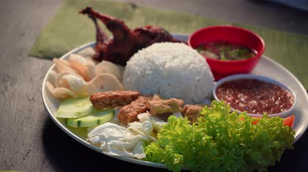 gevrek : nasi lemak kukus with  quail meat ,malaysian local food Stok Video
