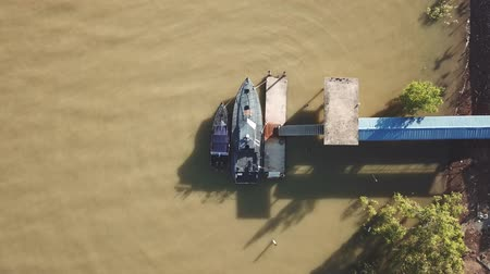 mangue : drone view of boats at fish jetty, malaysia