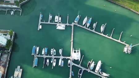 Aerial view of a lot of white boats and yachts moored in marina on a turquoise water Dostupné videozáznamy