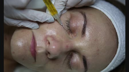 čelo : face plasmolifting cosmetology injections for skin rejuvenation patient and doctor