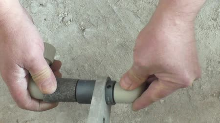 installation lectrique : Soldering plastic pipe. Worker heats the pipe and knee and connections using electrosoldering. Stock Footage