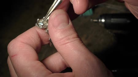 drágakő : Jeweler is inserting and fixing a gem on a ring.