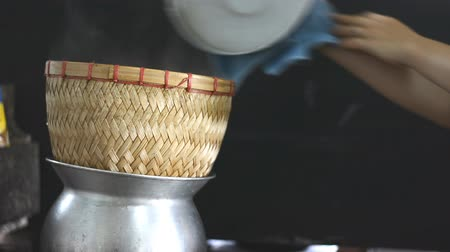 bamboo steamer : side view of sticky rice steaming in bamboo steamer