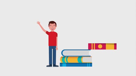 schoolkid : young man standing near stacked books Stock Footage