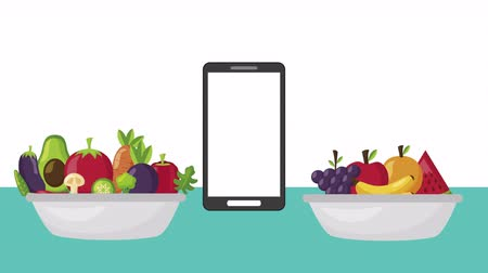 bakłażan : smartphone with fruits and vegetables healthy food ,4k video animation