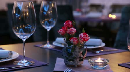setting : luxury restaurant table layout with red roses romantic dinner Stock Footage