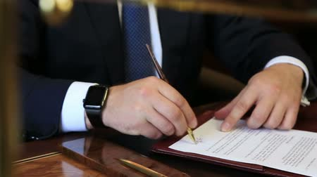 legal : business man sign papers with apple watch at his hand