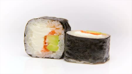 plating food : Syake avocado maki - Sushi roll with salmon, avocado and cheese rotating over white background, loop ready