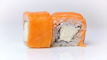 plating food : Syake fila maki roll raw salmon with cream cheese and avokado on white