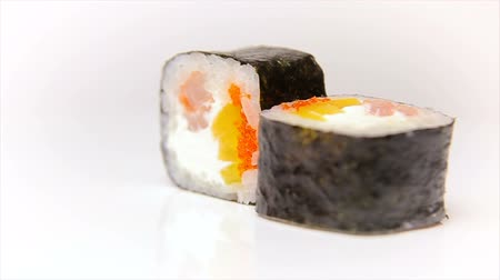 plating food : Kandzu maki sushi roll with flying fish roe, shrimp and fresh paprika Japan food