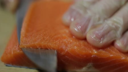 gunkan : knife slicing fresh raw salmon steak