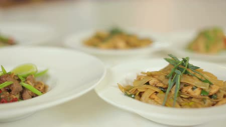 soğancık : Presentation of a delicious dinner. Risotto, pasta and stewed pork with vegetables