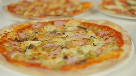 fresh cheeses : Presentation of Italian pizza. Assorted pizza for every taste. Marguerite, capricious, four cheeses, seasons. Slider dolly cam