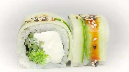 plating food : Chef adds soy sauce and sesame to Kappa Filla Maki with zucchini cheese and fresh salad sushi Stock Footage