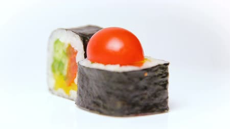 plating food : chef presentation of japan restaurant rotation on white Noris Maki sushi rolls with vegetables