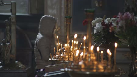 культ : Church candles religion Wax candles burn in the church during the festive prayer Стоковые видеозаписи