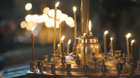 chapel : Church candles religion Wax candles burn in the church during the festive prayer Stock Footage
