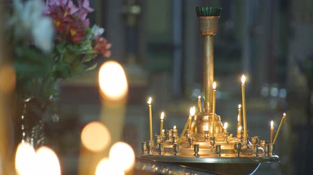 glare : Church candles religion Wax candles burn in the church during the festive prayer Stock Footage