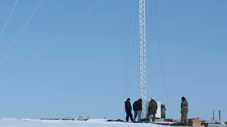 pager : Workers near the cell tower