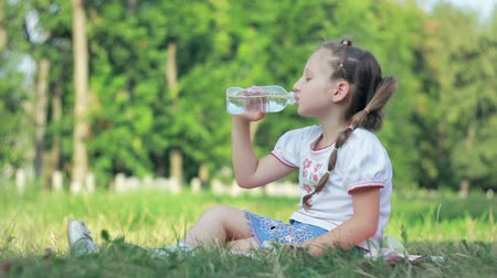 Girl drink water from bottle Stock Footage