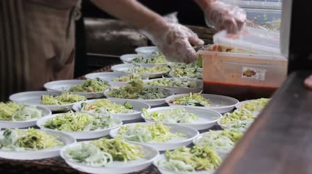 Street food - salad served on disposable plates