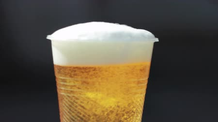 Plastic glass with beer