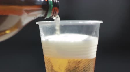 Plastic cup filled with beer