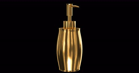 A gold bottle of liquid soap rotates. Alpha matte channel and loop. 4K footage. Stock Footage