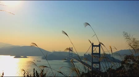 bridge man made structure : Time lapse of Tsing Ma Bridge at Summer - Tsing Ma Bridge is a bridge in Hong Kong. It is the worlds seventh-longest span suspension bridge.