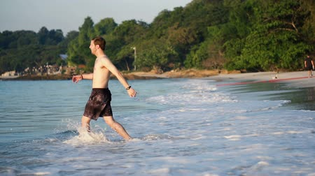 jump away : Slowmo Walking From Tropical Beach To Ocean and Then Diving Into Water
