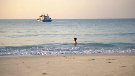plunging : Man Enjoying Warm Water in Tropical Ocean on Secluded and Peaceful Island Beach Alone