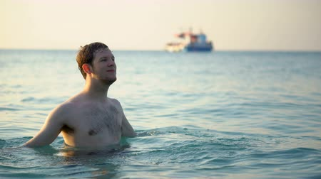 southeast : Man Enjoying Warm Water in Tropical Ocean
