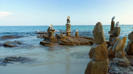 stacked rock : Stacked Stone Tower Statues on Tropical Beach Stock Footage