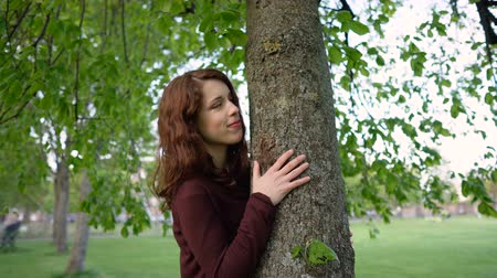hippi : Young Environmentalist Woman Hugging Tree Stock mozgókép