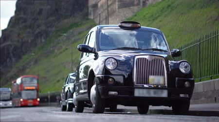 london cab : Iconic Black Cab British Taxi Parked on Street