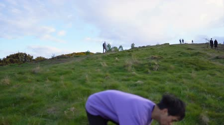 tripping : Jogging Man Stumbling and Rolling Down Hill Slow Motion - Injury From Falling Stock Footage