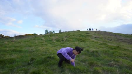 tripping : Man Trips and Falls Down on Floor and Rolls Down Hill Stock Footage