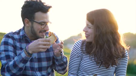 telített : Attractive Young Adult Spanish Couple Enjoying Time Together on Date in Nature Stock mozgókép